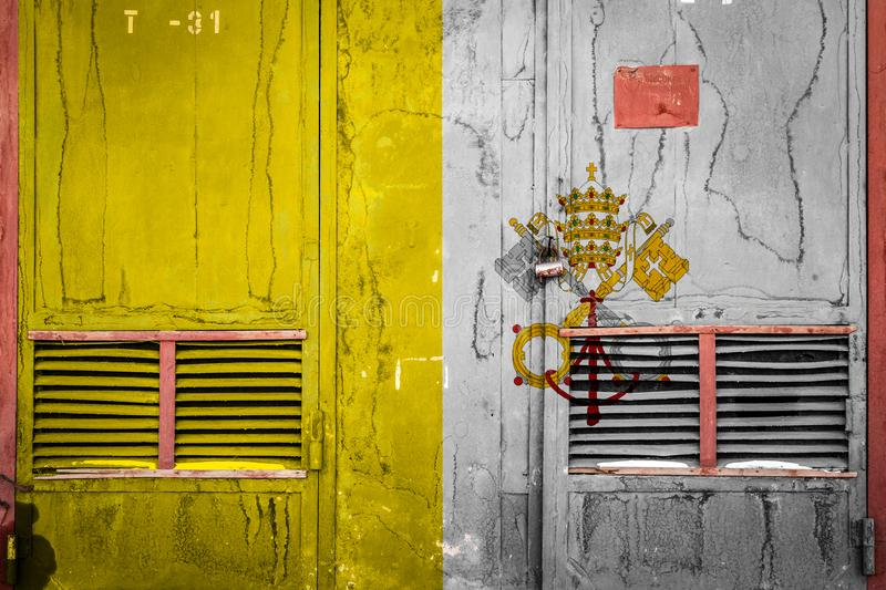 Close-up of old warehouse gate with national flag. Of Vatican. Concept of Vatican export-import, storage of goods and national delivery of goods. Flag in grunge stock illustration