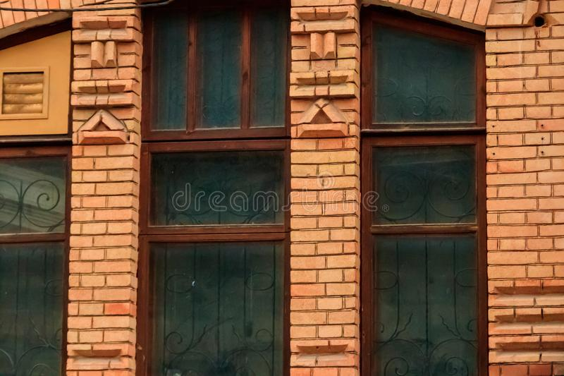 Close-up of old window in a red brick building facade. Close-up of old window in red brick building facade royalty free stock photos