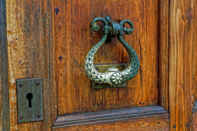 Close up of old wooden door handle in ortodox church royalty free stock images