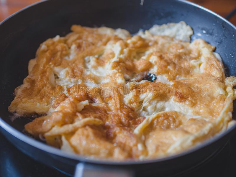 Close up the omelette in the pan. Omelette is easy to make and healthy. Delicious royalty free stock image
