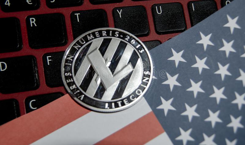 Close up of one litecoin over USA flag and keyboard stock photos