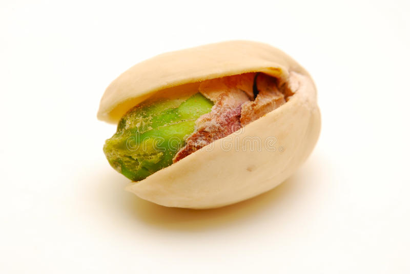 Close up of one pistachio nut isolated stock photos