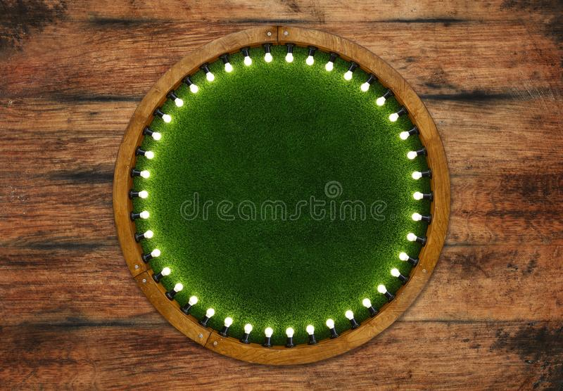 Wooden ring light frame with green grass backdrop royalty free stock photos