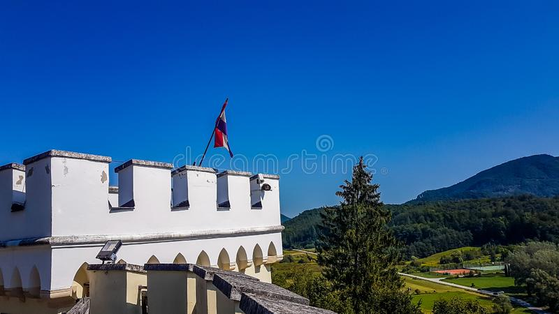 Varazdin - Castle on the hill. A close up on one of the towers of Trakoscan castle. On top of the tower there is Croatian flag. Clear and sunny day. There is no stock photo