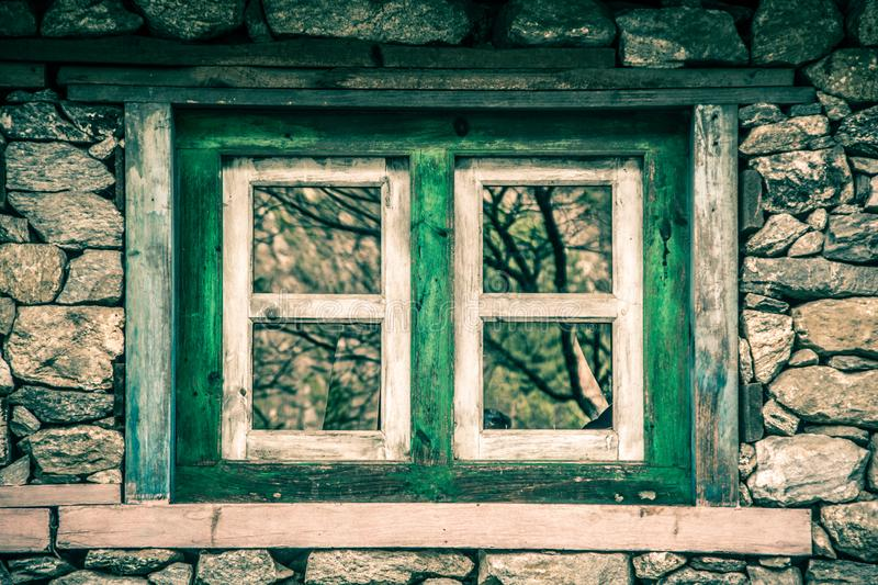 Close up of one wooden window on traditional stone house. stock image