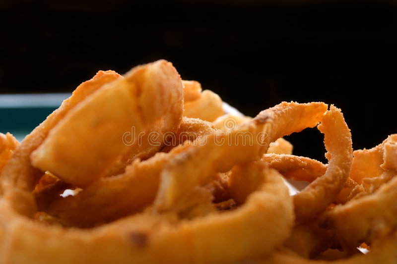 Close up on Onion Rings with Black Background royalty free stock image