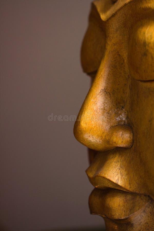 Close-up op het houten gezicht van Boedha stock foto's