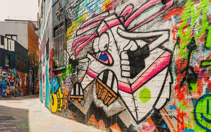 Close-up op het kunstwerk van de graffitimuur, Graffitistraat stock afbeeldingen