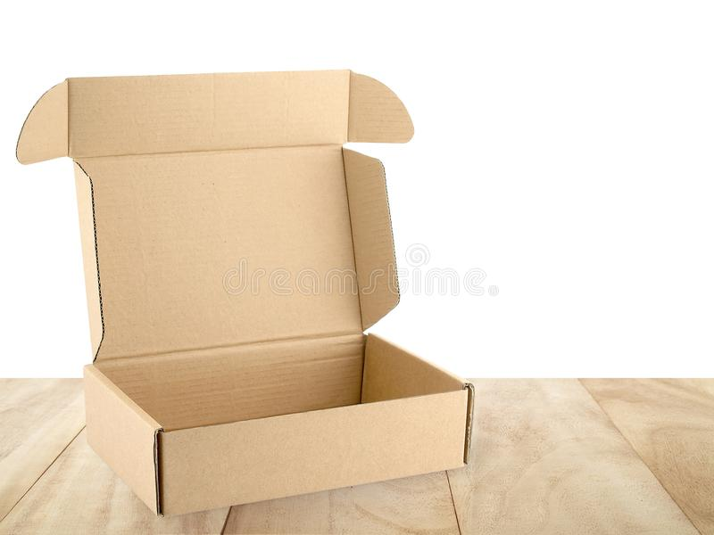 close-up single open empty brown carton box on wooden table isolated on white background royalty free stock photos