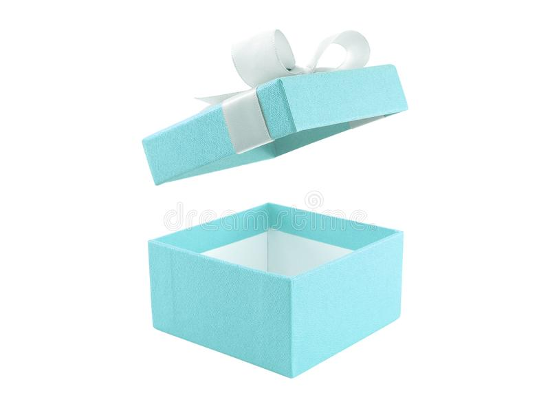 Close up open and empty single pastel blue color gift box with white ribbon bow isolated on white background. Lid is floating in the air, surprise in holiday royalty free stock images