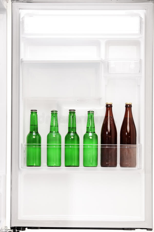 Close up of an open fridge full of beers stockbilder