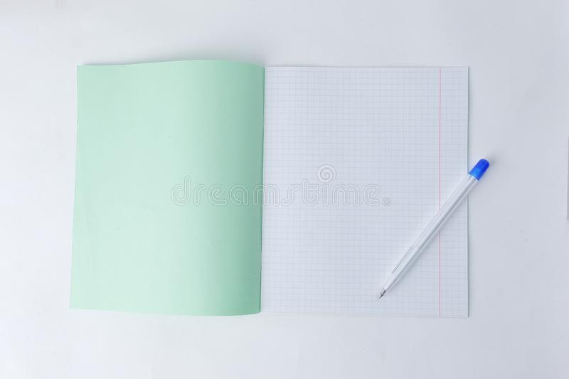 Close up.open school notebook in a cage and a ballpoint pen .photo with copy space stock photo