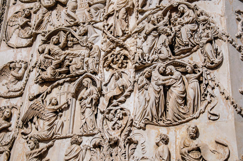 Close-up of the opulent and elaborated embossed sculptures in the Orvieto Cathedral at Orvieto. Close-up of the opulent and elaborated embossed sculptures in royalty free stock photo