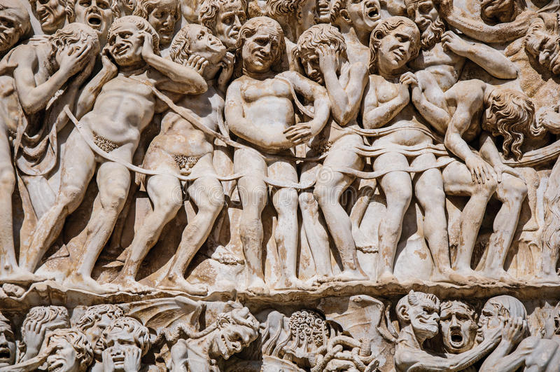 Close-up of the opulent and elaborated embossed sculptures in the Orvieto Cathedral at Orvieto. Close-up of the opulent and elaborated embossed sculptures in stock photo