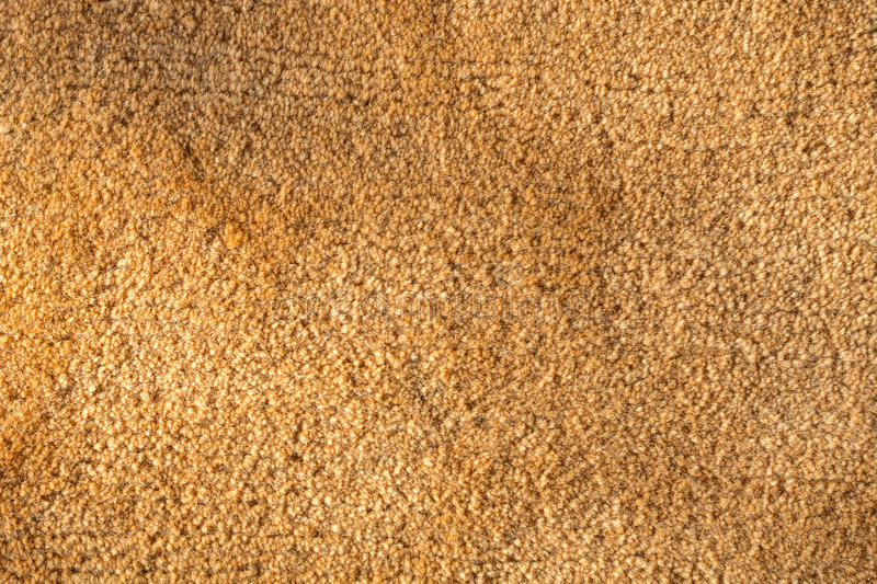 Close up of an orange carpet as a background stock photo