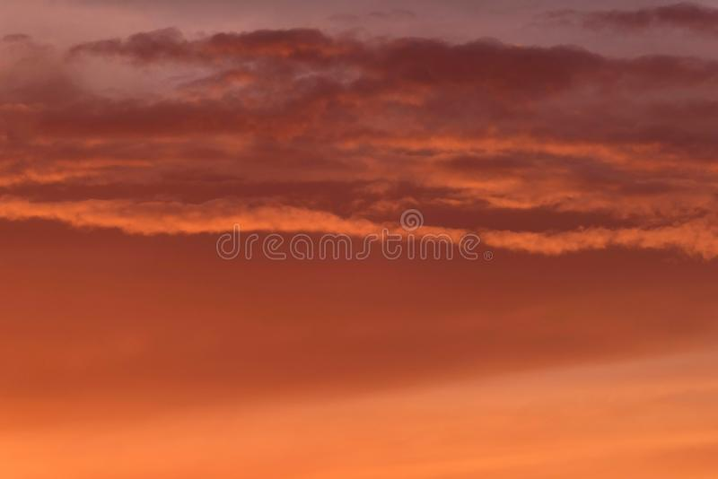 Close-up of orange coloured clouds. stock photos