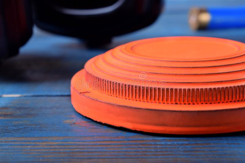 Close-up of orange flying target plate on blue wooden table royalty free stock photo