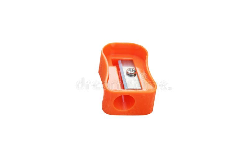 Orange pencil sharpener isolated on white background stock image