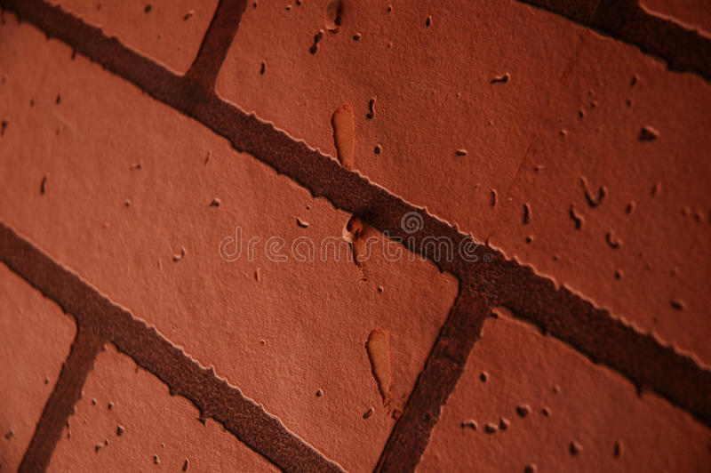 Close up orange / red brown brick texture wallpaper royalty free stock images