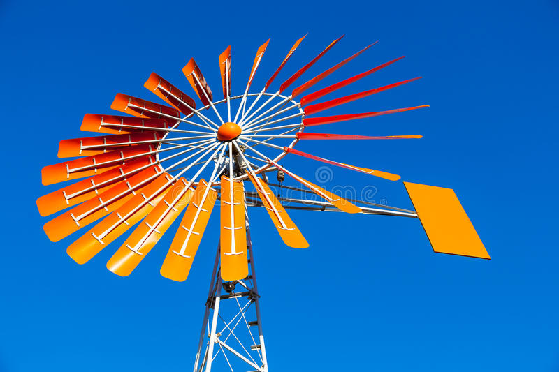 Download Orange Windmill Against A Blue Sky Stock Photo - Image: 30302458