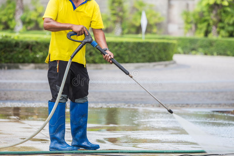 Close up Outdoor floor cleaning with high pressure water jet. Outdoor floor cleaning with high pressure water jet royalty free stock photo