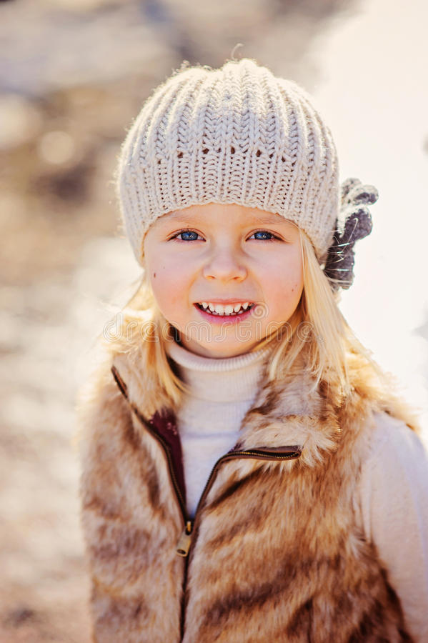Close up outdoor portrait of beautiful child girl looking at camera royalty free stock photos