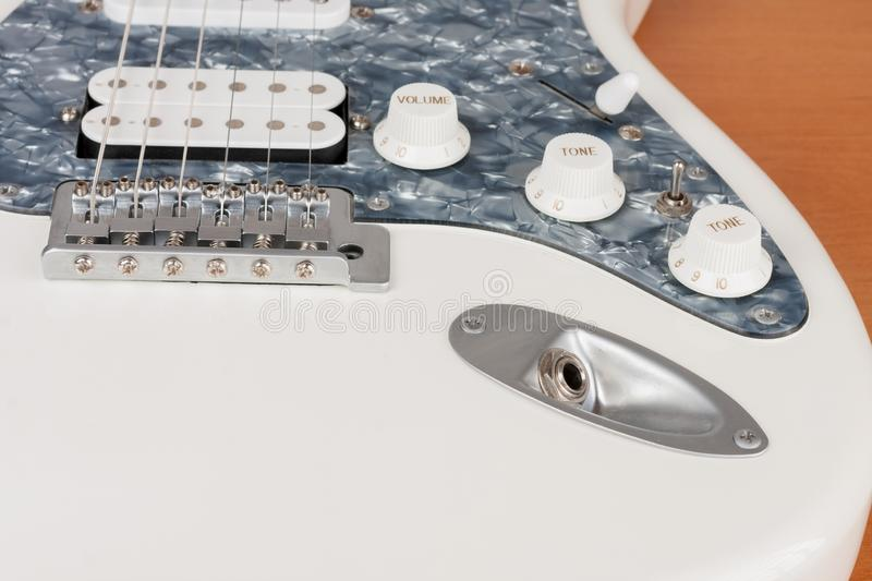 Close up output connector on white electric guitar, studio shoot royalty free stock photos