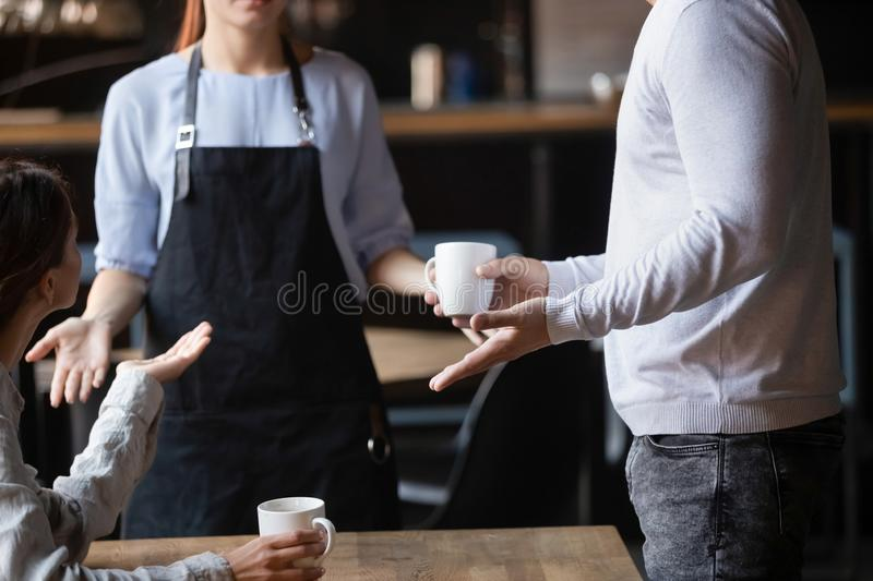 Close up outraged customers arguing with waitress, bad service concept. Close up outraged customers arguing with waitress in coffeehouse, bad service concept stock image