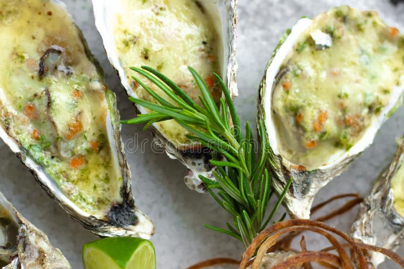 Close up oysters baked with cheese and lime. Italian cuisine with seafood. Food background for restaurant menu. Seafood royalty free stock photo