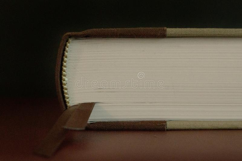 Close up of the pages of an closed old book stock image