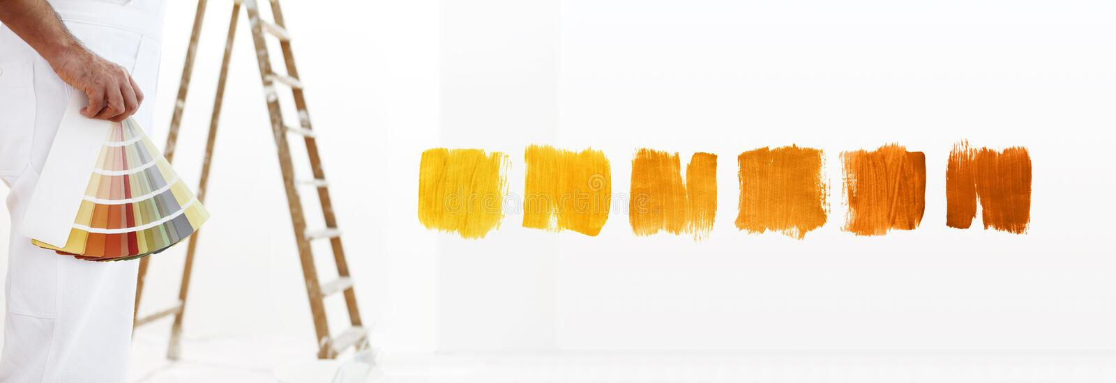 Close - up painter man with color swatches in your hand. Close - up, and color samples on white blank background royalty free stock photo