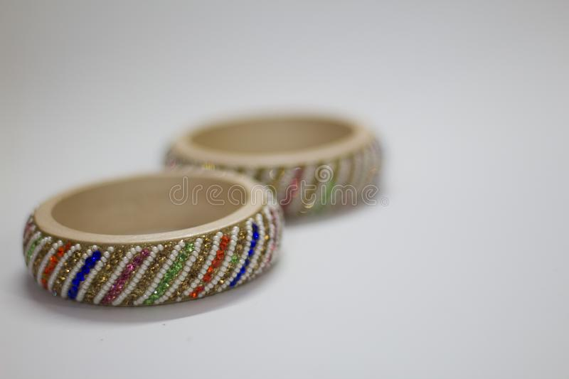 Close up of pair of bangles isolated on white background with space for text. A pair of bangles isolated on white background with space for text stock photo