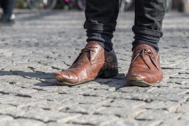 Close up of a pair of worn out shoes with relieved shoe sole.  stock photo