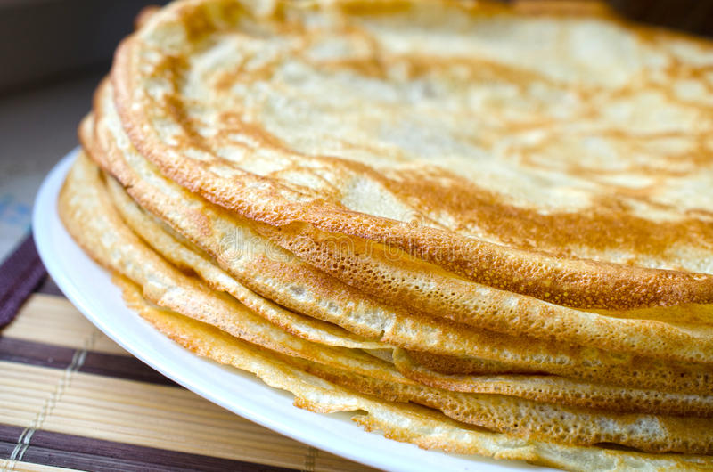 Close up of pancake. Background of Close up of pancake on white plate royalty free stock images