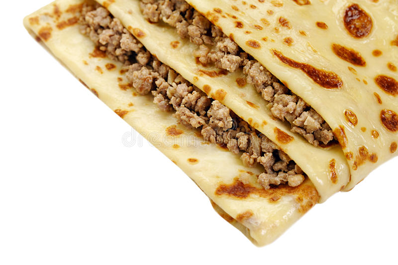 Close-up of pancake with meat isolated on white royalty free stock photos