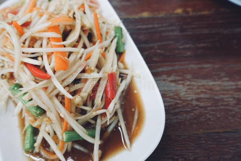 Close-up papaya salad is Thai local food very hot and spicy,delicious original from east of Thailand royalty free stock photo