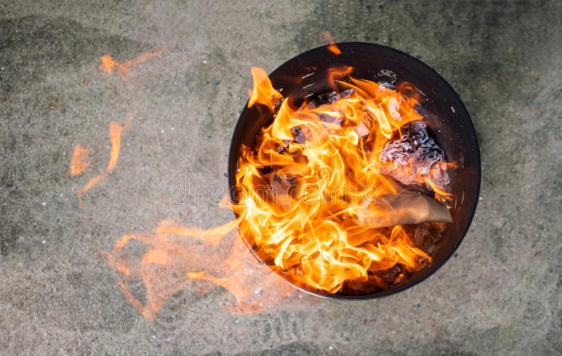 Close up paper burning in flame. Burning paper in the bin. royalty free stock images