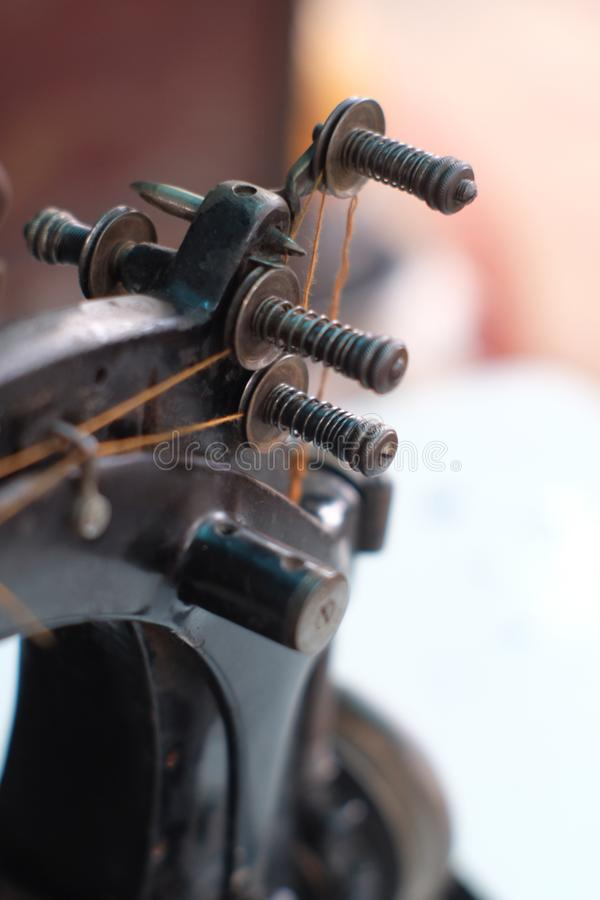 Free Close-up Part Of An Old Sewing Machine And Detail On Adjust Thread Royalty Free Stock Photo - 131025245