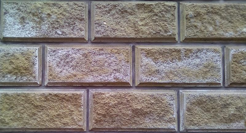 Close-up of part of the wall of decorative bricks. stock photo
