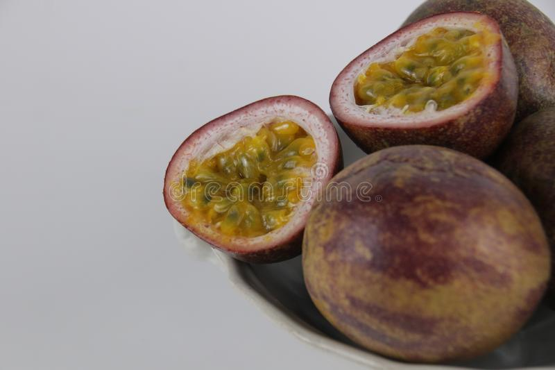 Close up Passion Fruit. Passion fruits on White Ceramic Tray on White Background stock images