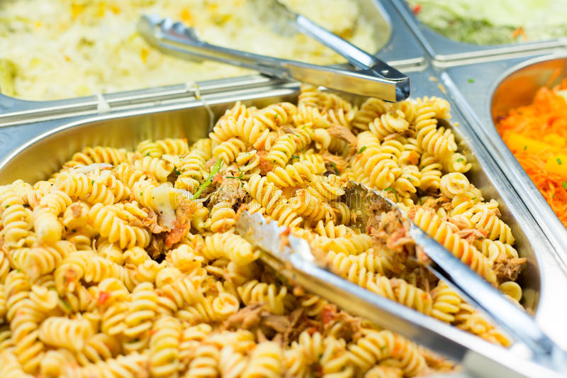 Close up of pasta and dishes on catering tray stock photo