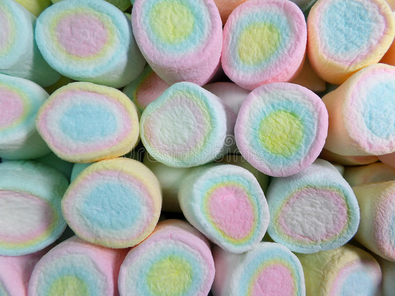 Close-up of Pastel Yellow, Pink, Blue Colored Marshmallows for Background stock images