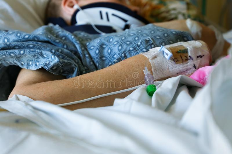 Close up of patient`s arm, shoulder and neck in hospital royalty free stock photo