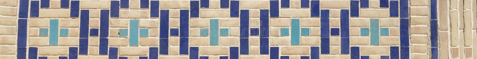Close up pattern of eastern, arabic ceramic, porcelain mosaic. Tiled background, oriental ornaments from Uzbekistan.  royalty free stock photo