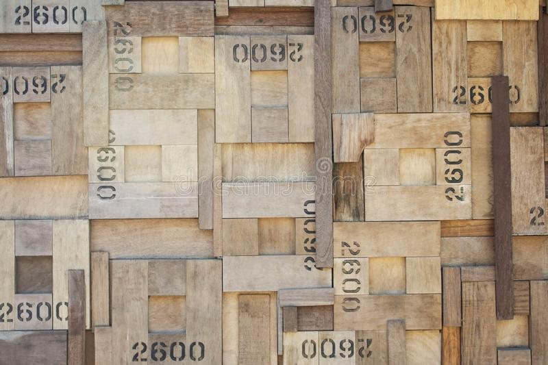 Pattern of wooden squares wall with figures royalty free stock photography