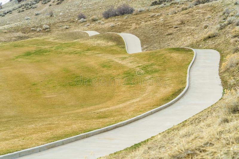 Close up of a paved pathway running through the slope of a mountain stock photo