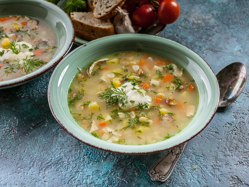 Close-Up Pea soup with smoked meat, vegetables and greens. Delicious and healthy homemade food. Delicious and healthy homemade food. Close-Up Pea soup with stock photography