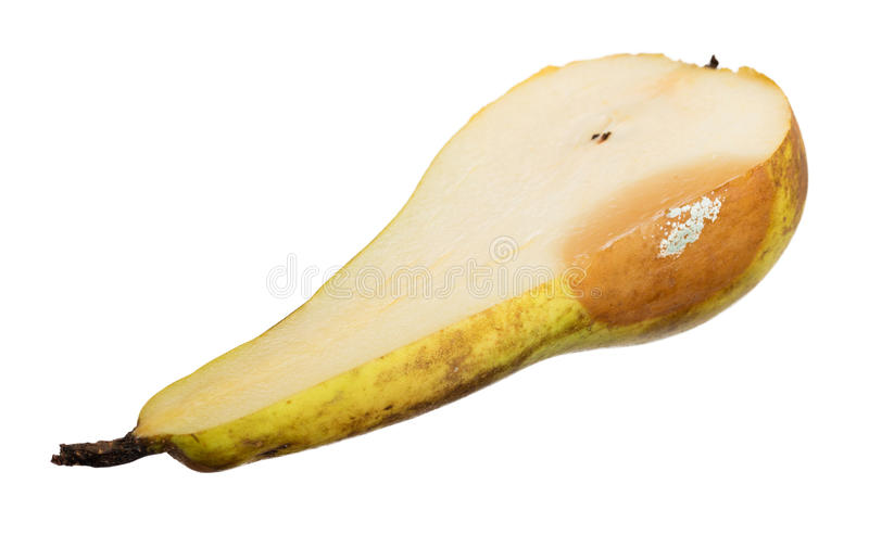 Close up of a pear with white area of fungus growing on it, sele stock photography