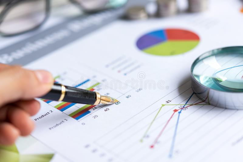 Close up pen on the financial chart with statistics accounting info which including of many economic statistics business. Business Concept stock photography