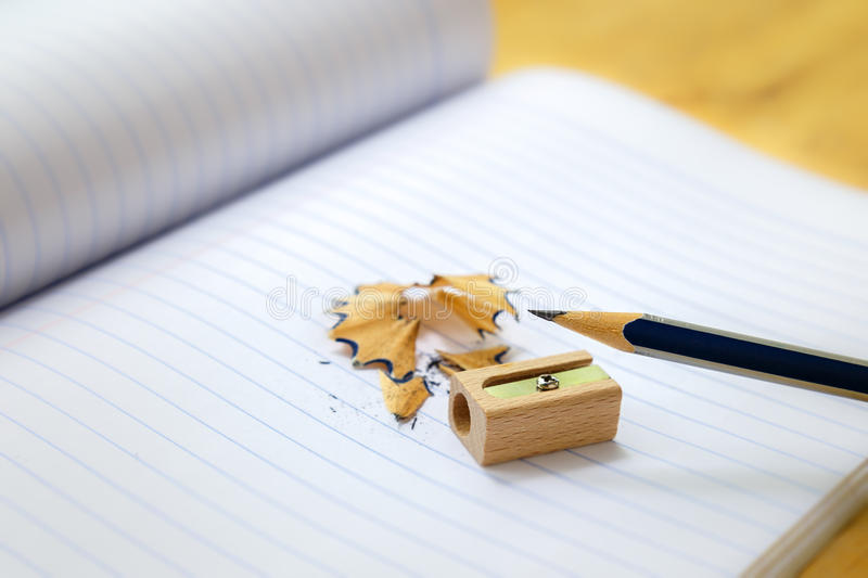 Close-up of pencil, sharpener and shavings. royalty free stock image